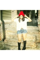 red hat - black combat boots - beige button down shirt