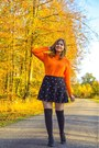 Black-boots-orange-sweater-black-over-the-knee-socks-black-skirt