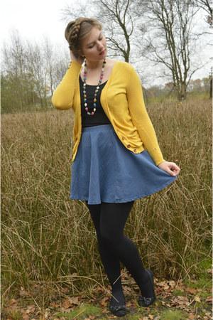 gold cardigan - black tights - black top - blue skirt - black flats