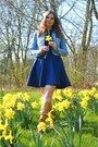 Bronze-boots-sky-blue-denim-jacket-navy-skirt