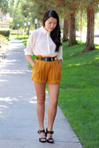 mustard high-waisted shorts - ivory sheer blouse - black heels