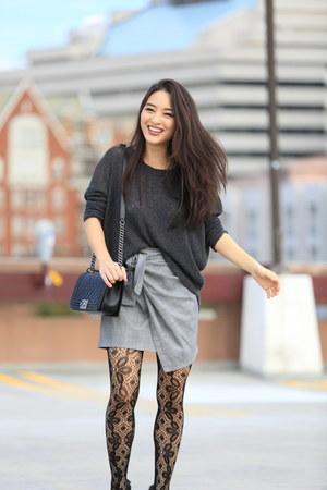 heather gray asymmetrical Metisu skirt - black boy Chanel bag