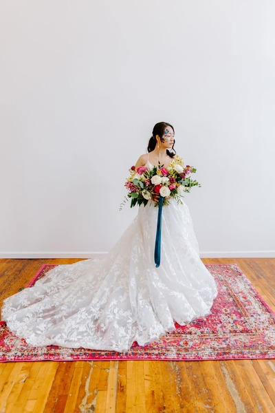 white K and B Bridals dress