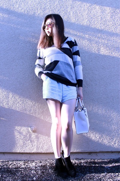 black boots - black sweater - white purse - light blue shorts