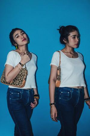 white Walmart t-shirt - blue Walmart jeans - tan coach bag
