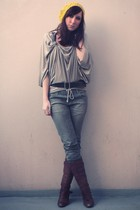 gold hat - beige top - silver jeans - brown boots - brown belt