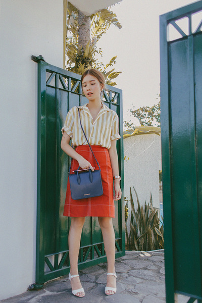 navy Strathberry bag - burnt orange Uniqlo and Lemaire skirt