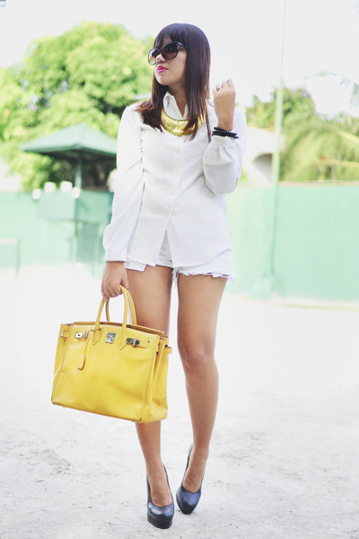 white levis shorts - mustard bag - white white top - black gold dot pumps