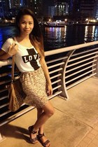 off white New Yorker t-shirt - mustard KPark skirt - black Aldo sandals