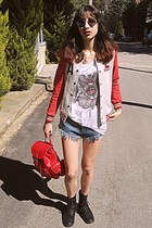 silver varsity jacket - black boots - red backpack bag
