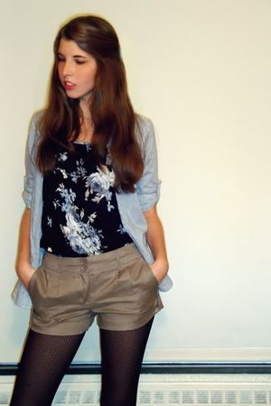 blue shirt - black top - brown shorts - black tights