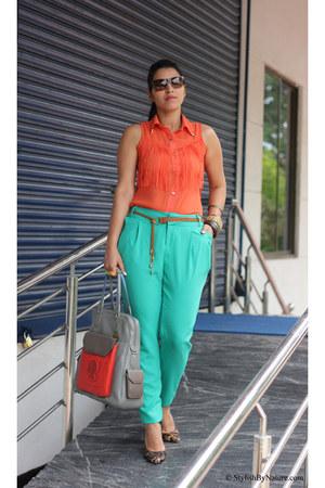 carrot orange solilorcom shirt - chartreuse solilorcom pants