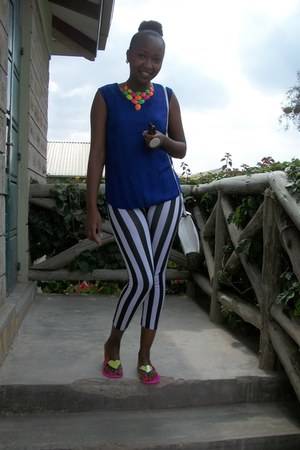 striped leggings - black and white purse - sheer blue blouse - necklace