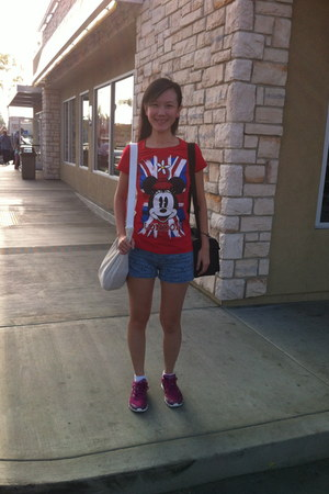 red Disney shirt - white Billabong bag - blue cotton on shorts