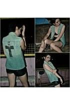 green vest with cross vest - black shinny shorts shorts - black bra
