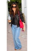 Flared blue jeans - Leather Biker jacket - Chanel maxi purse - Prada sunglasses