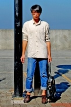 Lacoste top - Folded and Hung pants - Pedro shoes - Wade Bags - Givenchy glasses