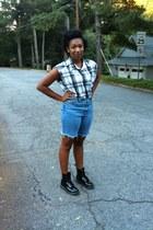 high waisted shorts - doc martens boots - plaid cut up shirt