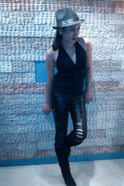 black Black YRYS haltered backless top  and ripped pants paired witha knee high