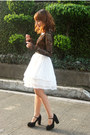 White-skirt-black-heels-black-blouse-salmon-necklace-camel-belt
