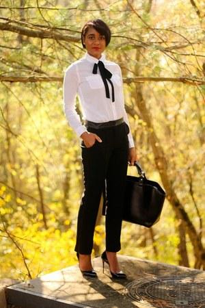 black Christian Louboutin heels