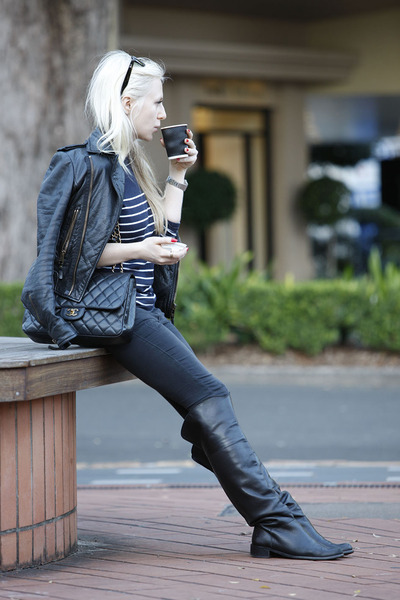 classic flap Chanel bag - over the knee Brando boots