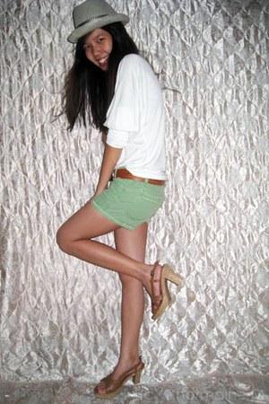 dark khaki hat - chartreuse maong shorts - brown sandals - white top - burnt ora