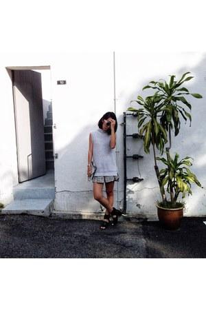 dark gray pleated cotton TheScarletRoom shorts - white sling Monki bag