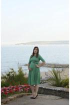 black Christian Louboutin heels - green asos dress