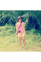 red bag - black hat - light yellow unbranded shorts - dark brown sunglasses