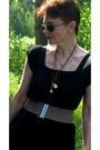 Black-leather-jacket-mustard-necklace-light-brown-belt-black-skirt