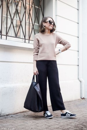 black Celine bag - nude Equipment sweater - black The Row sunglasses