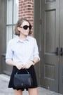 Light-blue-club-monaco-shirt-black-anya-hindmarch-bag