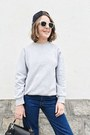 Navy-levis-jeans-black-anya-hindmarch-bag-white-ray-ban-sunglasses