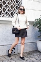 black Saint Laurent bag - ivory SANDRO sweater - black The Row sunglasses