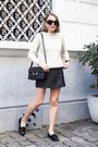Ivory-sandro-sweater-black-saint-laurent-bag-black-the-row-sunglasses