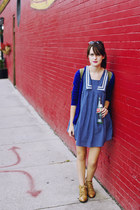 blue sailor dress - camel leather ecote boots - army green backpack Nollie bag