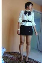 black accessories - black shoes - yellow shirt - black Express skirt