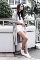 white Insight shorts - white cotton on t-shirt - white axel arigato sneakers