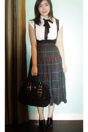 black polo random brand shirt - black bag Prada bag - gray checkered skirt vinta