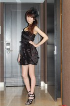 black ruffled mini dress - black strappy sandals - black feather hat