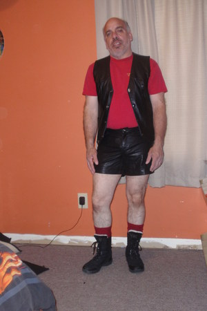 leather vest - black boots - leather shorts - red t-shirt