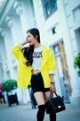 Yellow-coat-black-bag-black-shorts-white-bodysuit
