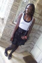 black cross bag - black mesh vest - black ruffled skirt
