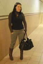 brown up neck t-shirt - brown boots - black sleevless shirt - grey Ver pants