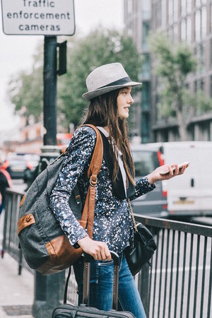 suitcase bag - backpack bag - Burberry bag - jeans - fedora hat - printed blazer