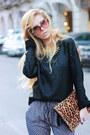 Black-sweater-bronze-accessories-violet-pants-black-heels