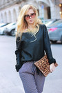 Black-sweater-bronze-accessories-violet-pants-black-heels