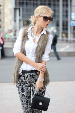 light brown vest - white shirt - black bag - black pants - white necklace