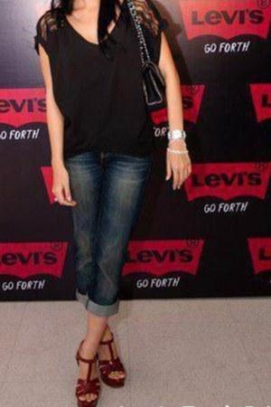 black bag - blue pants - black top - heels